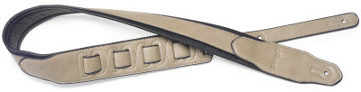 Beige padded leatherette guitar strap with a triangular end